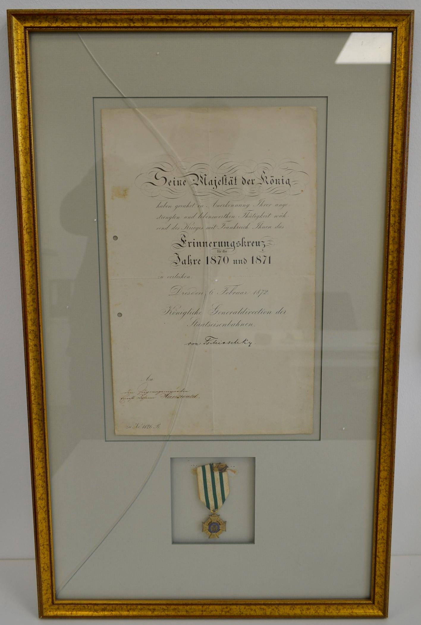 Vier Dokumente, jeweils im Bilderrahmen. 1) Decret zur Verleihung ...